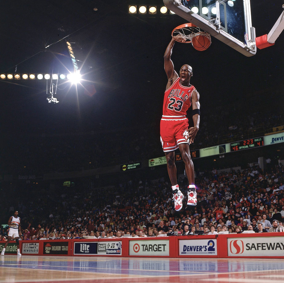 Michael Jordan finishes off a fast break with an emphatic slam dunk against the Denver Nuggets in November 1991. Jordan scored 38 points with 12 assists and seven rebounds in a wild 151-145, come-from-behind win.