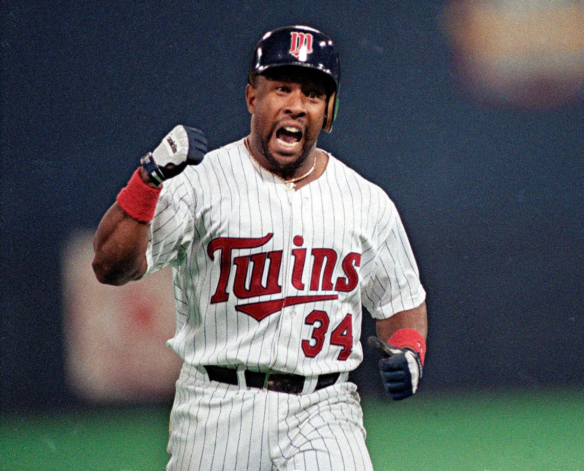 Kirby Puckett pumps his fist in celebration as he rounds the bases after his game-winning home run in Game 6 of the World Series.