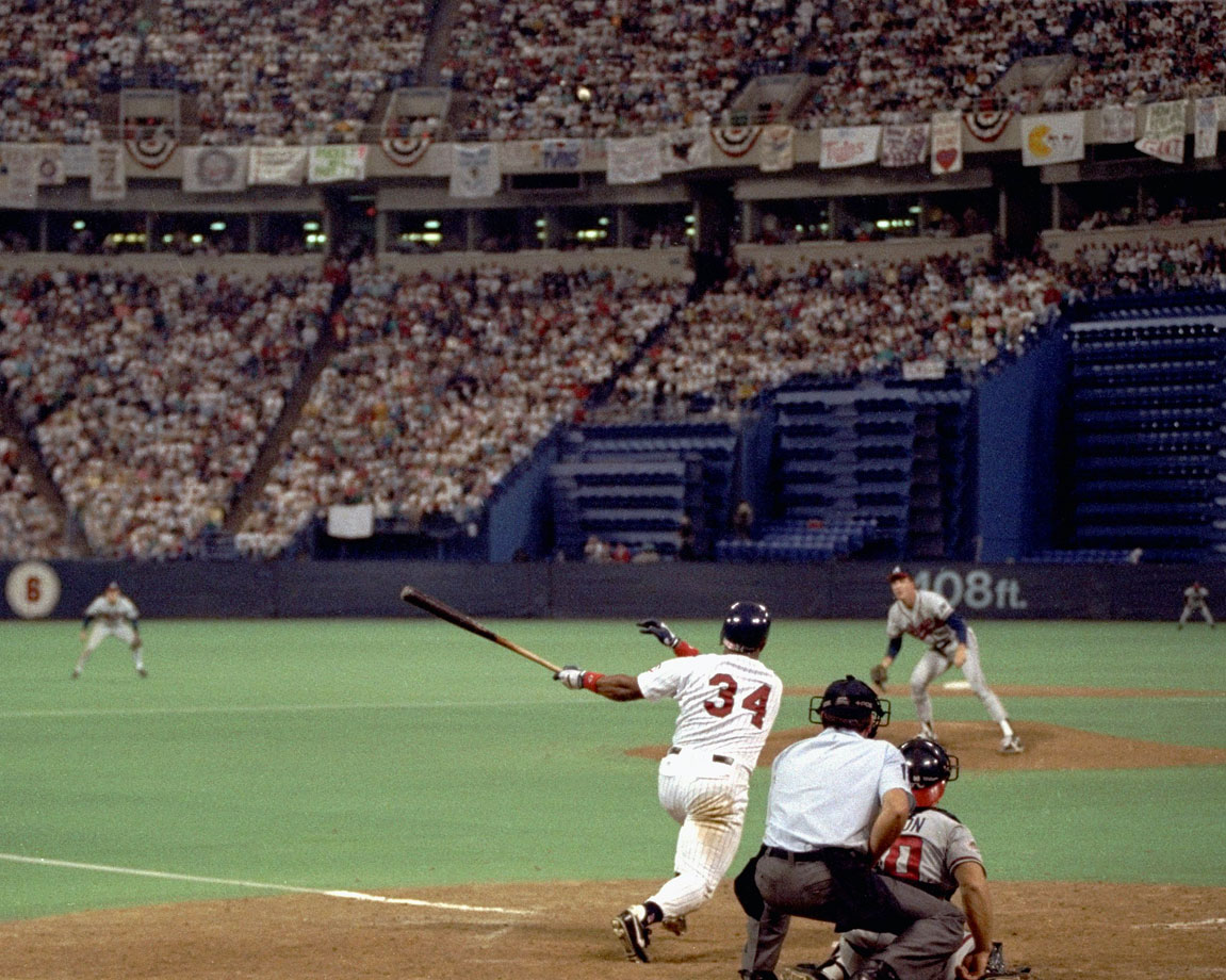 Kirby Puckett hits the game-winning home run off Braves pitcher Charlie Leibrandt in the 11th inning of Game 6 of the World Series at the Metrodome to force a Game 7.