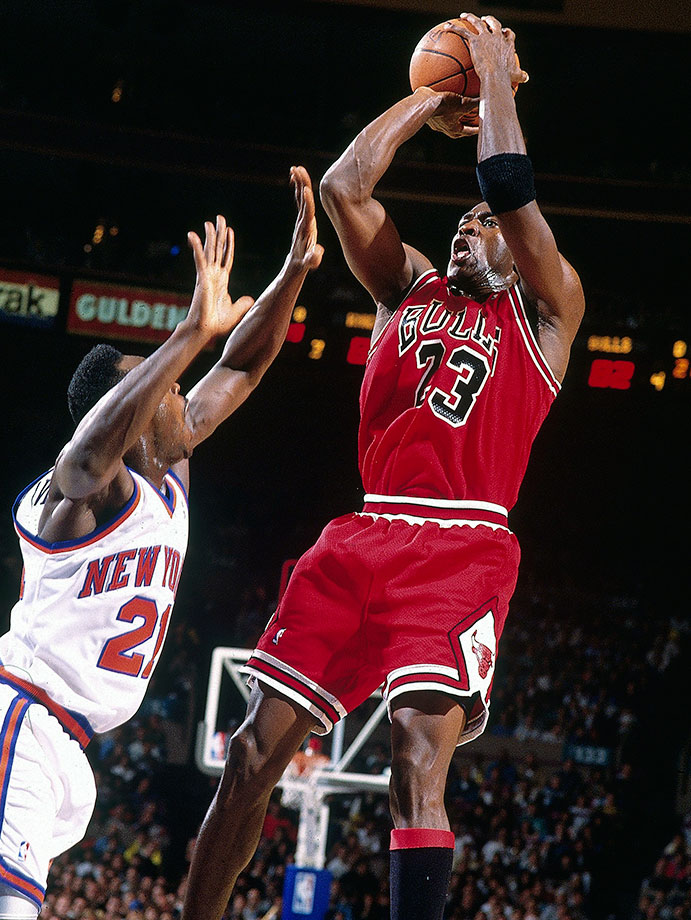Michael Jordan takes a fadeaway jumper against the New York Knicks in Game 4 of the Eastern Conference semifinals in 1992. He averaged 31.3 points during the series, capping it off with a 42-point performance in Game 7 to advance to the Eastern Conference Finals.