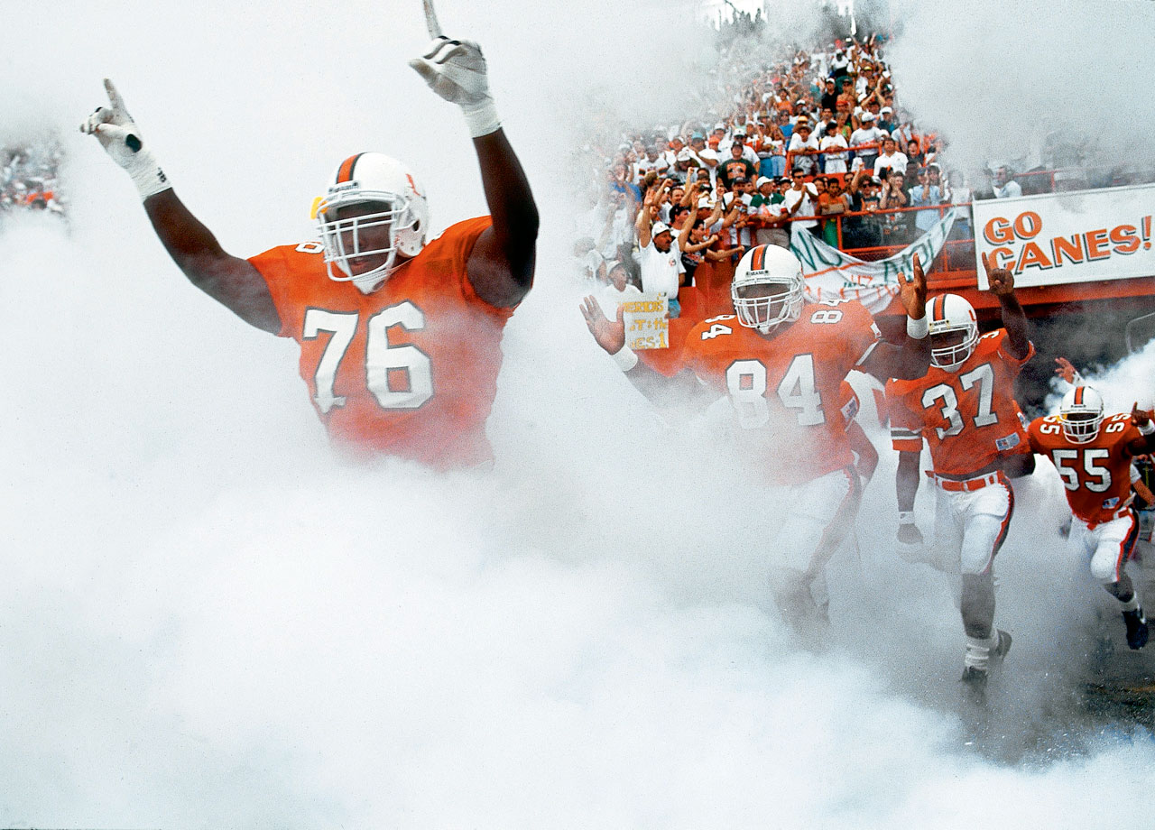 Warren Sapp takes the field with his Miami teammates before their game against Florida State on Oct. 3, 1992 in Miami.  The Hurricanes won the game, 19-16.