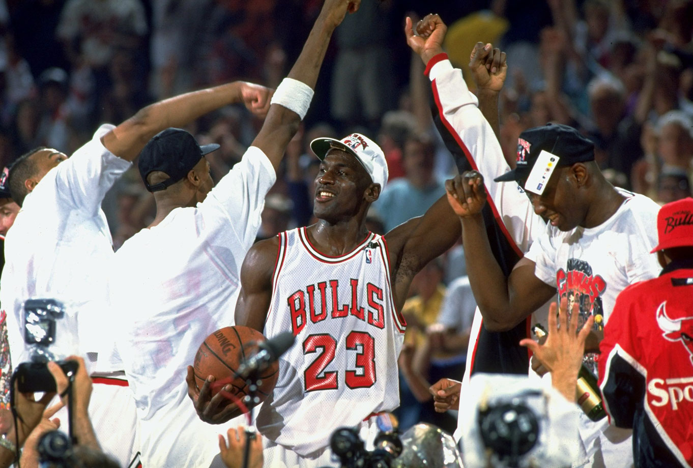 Michael Jordan celebrates the Bulls' repeat as NBA champions after dropping the Portland Trail Blazers in six games in 1992. He earned his third MVP Award and second consecutive Final MVP.