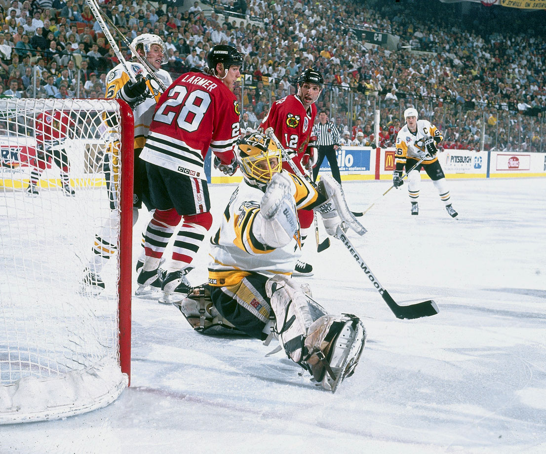 Former Calder and Vezina Trophy winner Tom Barrasso was red-hot during Pittsburgh's run to its second consecutive Stanley Cup. The netminder backstopped 11 wins in a row, including a sweep of the Chicago Blackhawks in the final. Here he is in action during the Penguins' 3-1 win in Game 2.