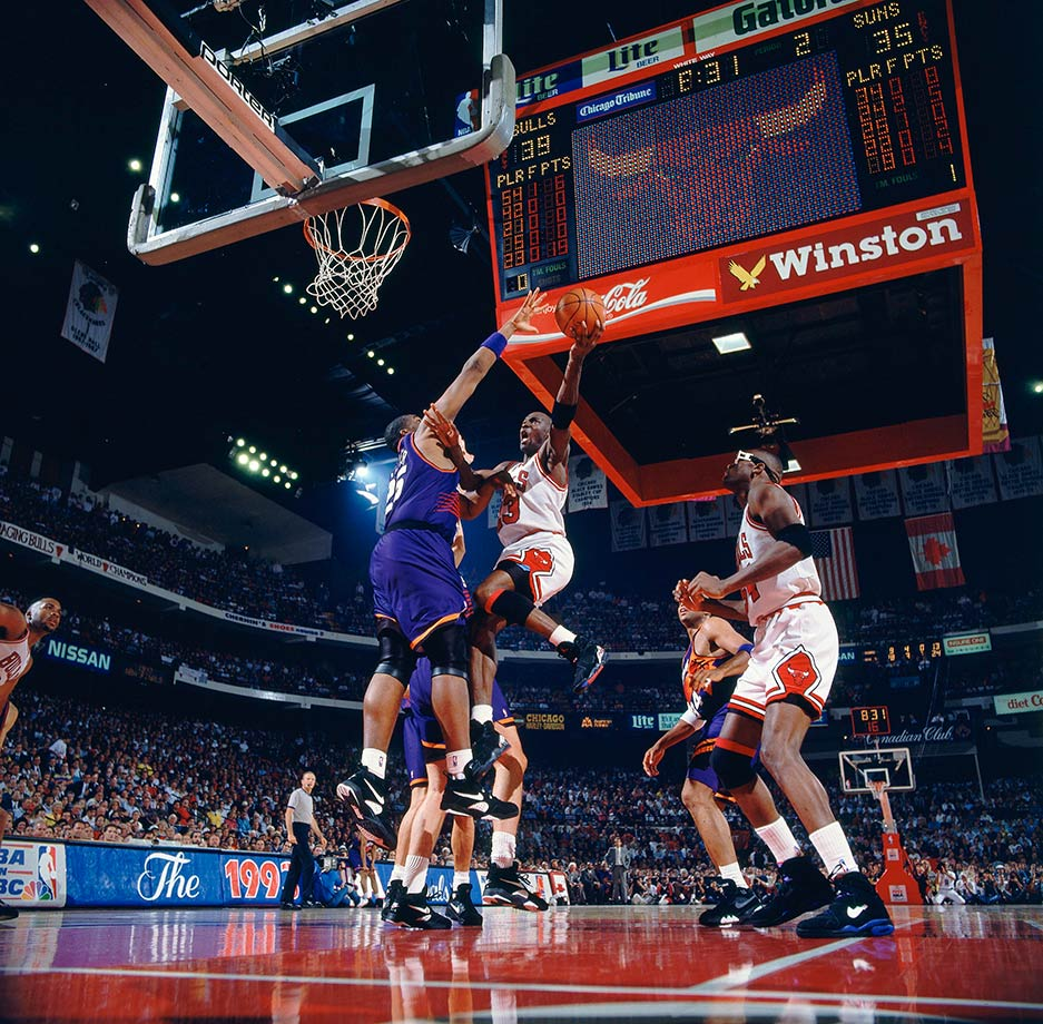 Michael Jordan rises up to the hoop against the Phoenix Suns in Game 4 of the 1993 NBA Finals. Jordan shrugged off the building off-court controversy about his gambling habits to lead the Bulls to their third straight championship.
