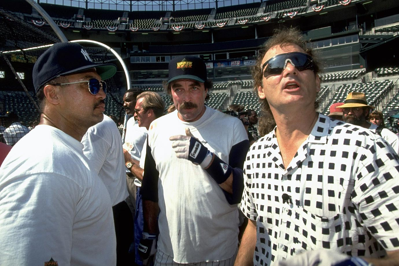Reggie Jackson, Tom Selleck and Bill Murray look on during the Old Timers Game on July 13, 1993 at Oriole Park at Camden Yards in Baltimore.