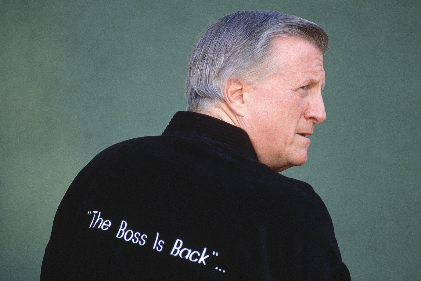 """George Steinbrenner poses in a robe that reads """"The Boss Is Back""""... on Feb. 15, 1993 at his home in Tampa, Fla."""