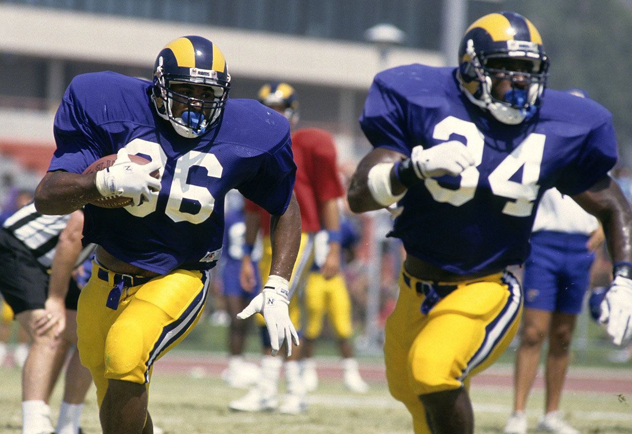 Running backs Jerome Bettis (36) and Tim Lester work on their form at Rams' camp. Bettis was the first round selection, 10th overall, of the Rams from the University of Notre Dame.