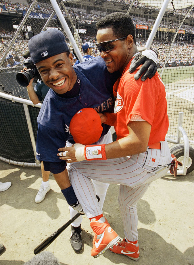 While his father was mostly a singles and doubles hitter, Ken Griffey Jr. is a power hitter from almost the moment he sets foot in Seattle. In 1993, he wins the Home Run Derby at the All-Star Game in Baltimore, and becomes the only person ever to hit a ball off the warehouse beyond the right field fence.  Here, Griffey clowns around with Barry Larkin before the Derby.