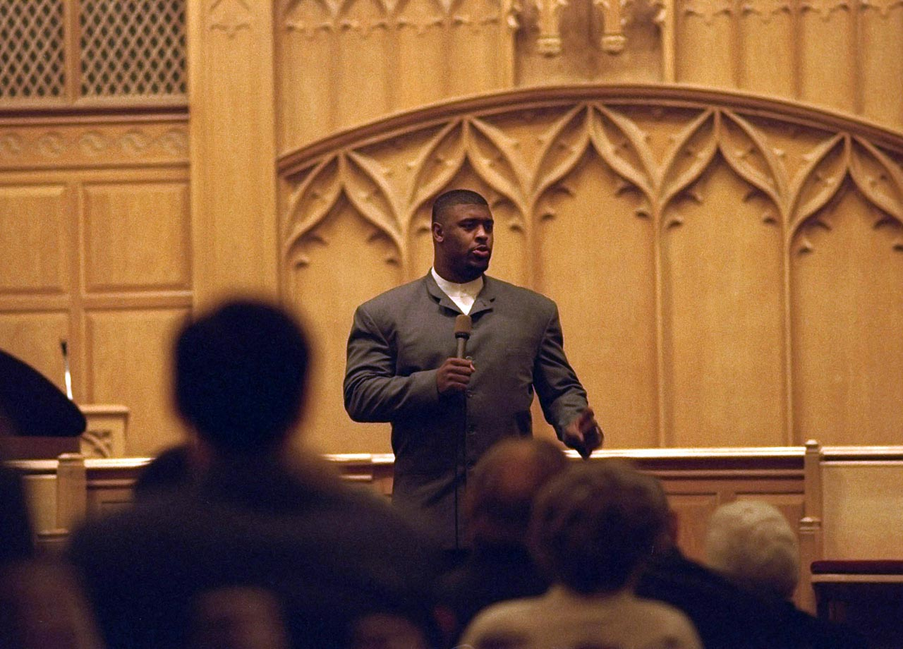 Free agent DE Reggie White delivers a sermon at Dallas First Baptist Church on March 7, 1993 in Dallas, Texas.
