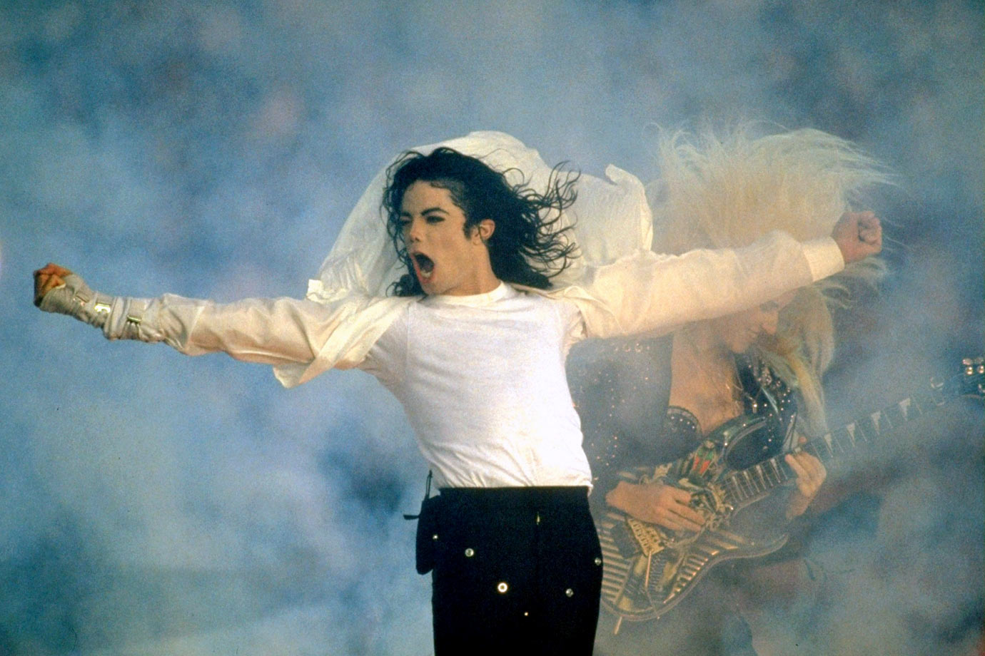 "The then-undisputed King of Pop moonwalked through smoke and blazing pyrotechnics, delivering a medley of hits: ""Jam,"" ""Billie Jean"" and ""Black or White."" Surrounded by 3,500 local children (insert your own joke here), Jackson closed the set with ""Heal the World."" NBC aired the entire performance live, and never again would a network cut away from a halftime show."