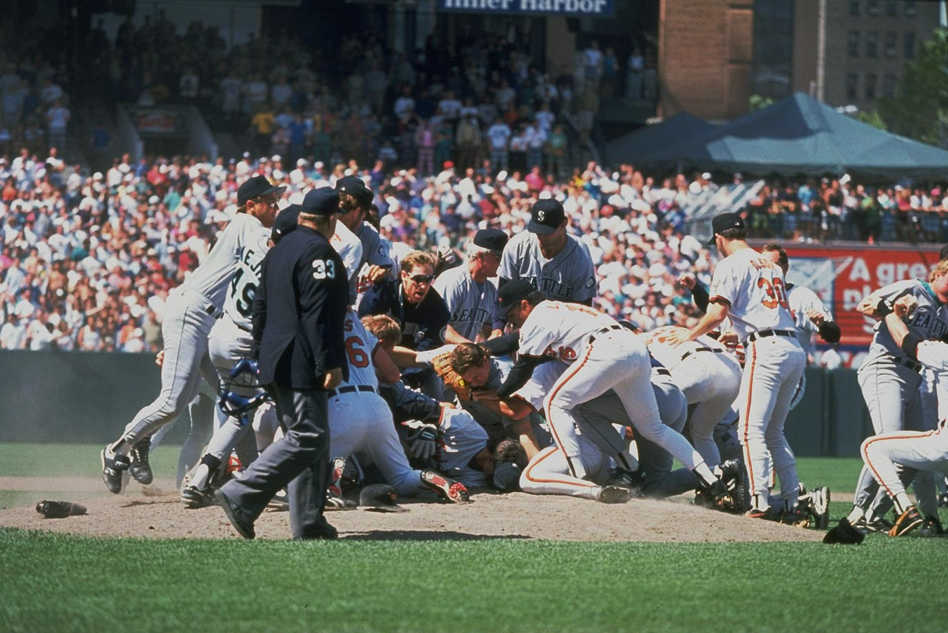 By the time the Orioles' Mike Mussina hit Bill Hasselman in the shoulder with a high fastball in the seventh inning, tempers in this game were already running hot. Once plunked, Hasselman charged Mussina, and amid the ensuing 20-minute scuffle, Bosio re-fractured his left collarbone, an injury from which he had just returned after missing a month. He missed another 19 days and served a five-game suspension upon returning, while six other players drew suspensions of three to five games as well. Hasselman received only a three-gamer, but Mussina wasn't disciplined even though Piniella claimed that an Oriole told him that the plunking had been ordered.