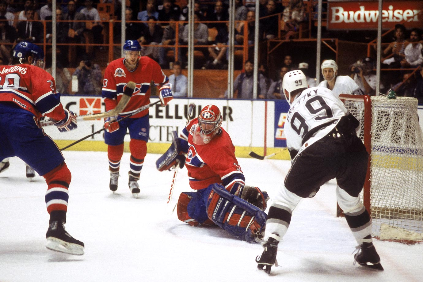 "Five years after his arrival in Los Angeles, Wayne Gretzky led the Kings to their first Stanley Cup Final appearance. Unfortunately, nonpareil netminder Patrick Roy was waiting. Gretzky was ""limited"" to two goals and five assists in the series as Roy earned Conn Smythe honors for the second time as Montreal took the Cup in five games."