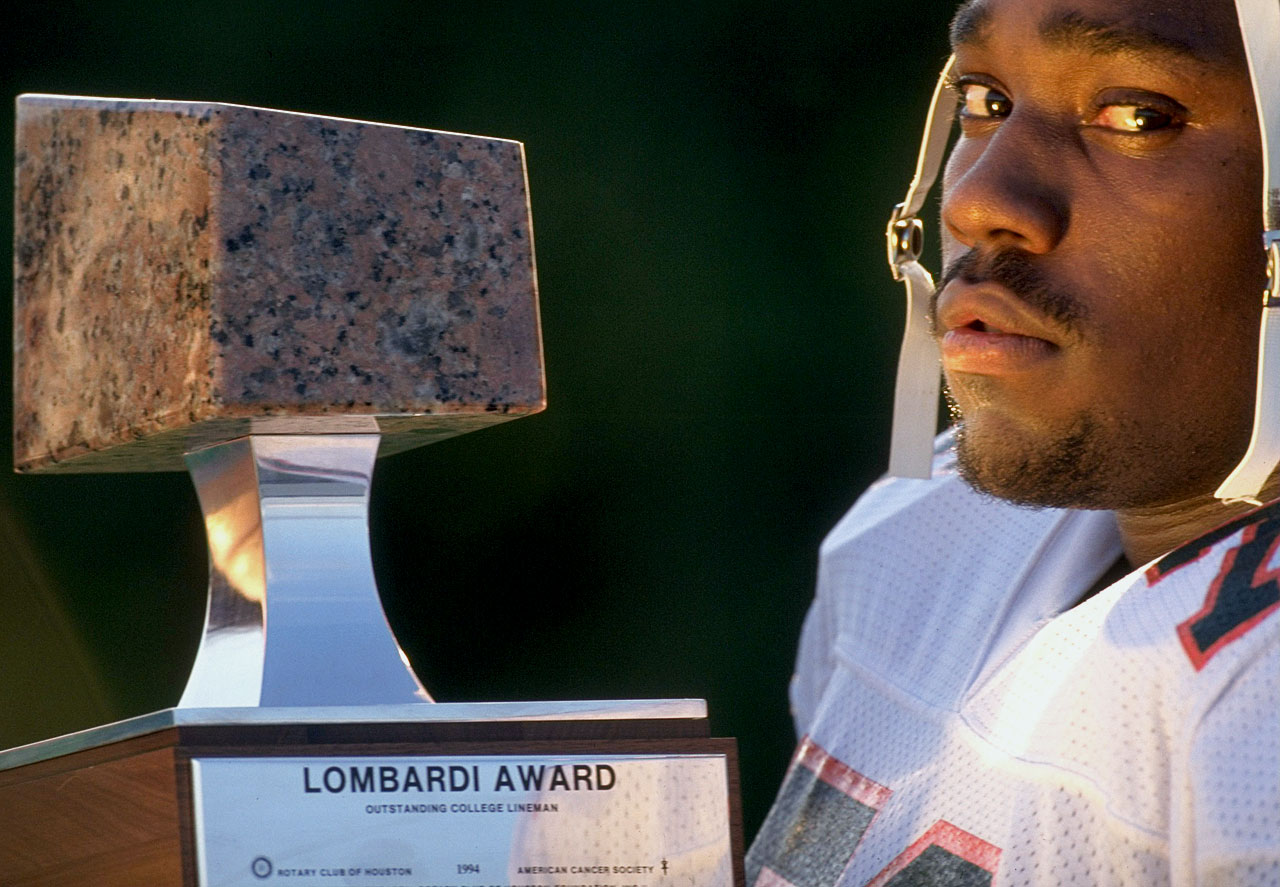 Warren Sapp poses with his Lombardi Award for best college football lineman or linebacker on Dec. 6, 1994 in Miami.