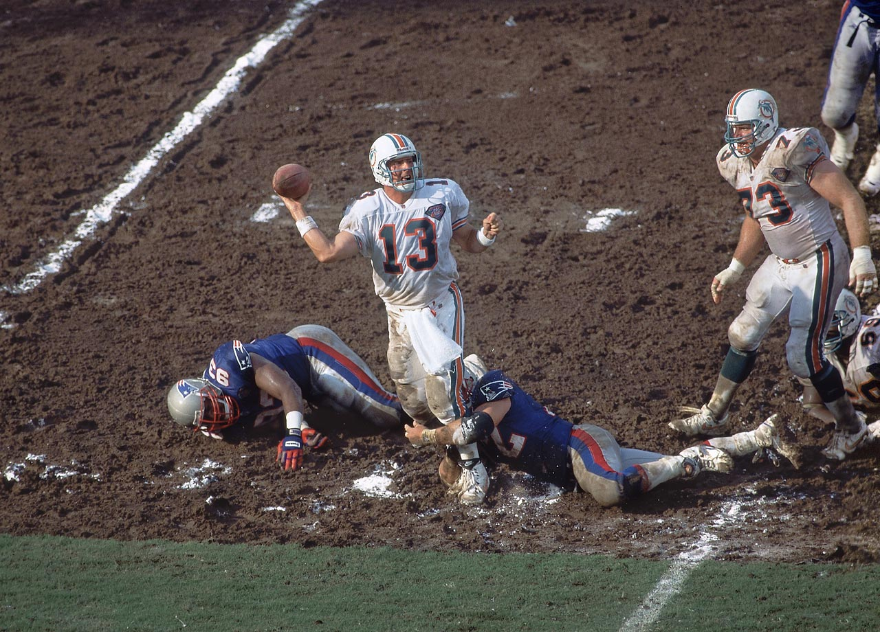 Dan Marino had to contend with the Patriots' rush and a ravaged field in Miami.