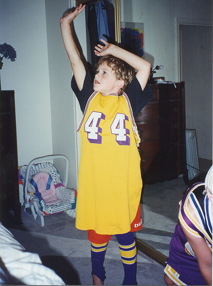 A five-year-old Kevin Love rocks a sweet Jerry West jersey.