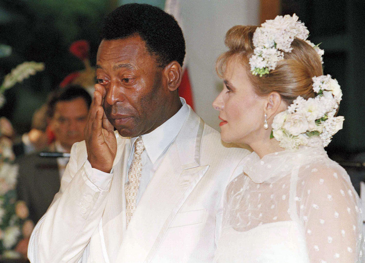 Pelé wipes away tears during his wedding with Assiria Seixas Lemos on April 30, 1994 in the coastal town of Recife, Brazil.  More than 170 state police guarded the couple and 300 guests at the Anglican Episcopal Church. It was the second marriage for both.
