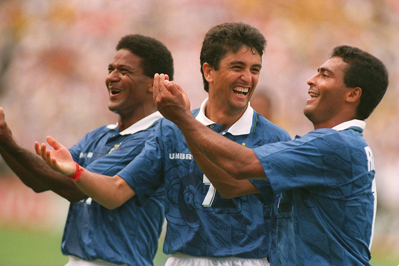 "Bebeto celebrates a goal in the 1994 World Cup with his now-famous ""baby cradle"" celebration."