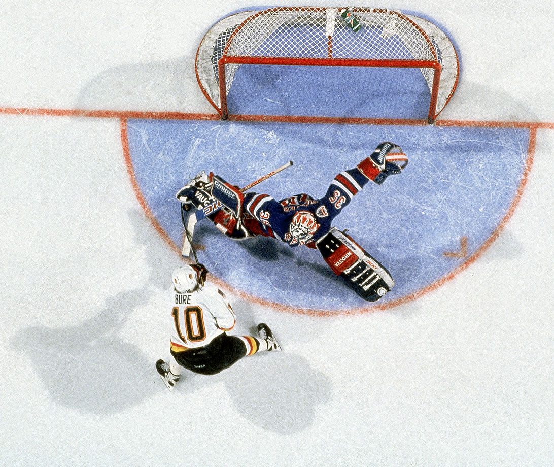 "Vancouver's dangerous ""Russian Rocket"" was thwarted on this Game 4 penalty shot by Rangers netminder Mike Richter, who played brilliantly in the seven-game series. New York prevailed in this match, 4-2"