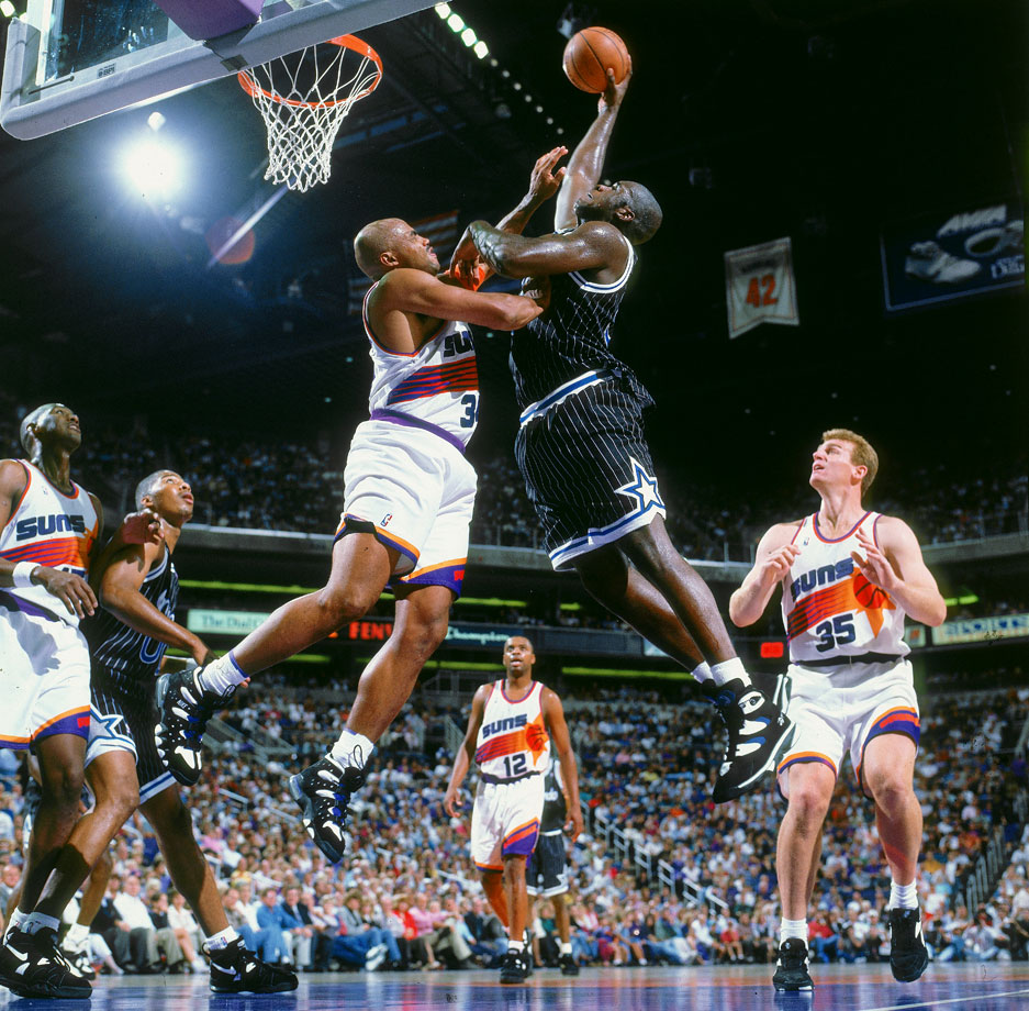 Shaquille O'Neal of the Orlando Magic goes up for a shot against Charles Barkley of the Phoenix Suns during a game in 1994. (Posted March 6 -- Shaq's 42nd birthday)