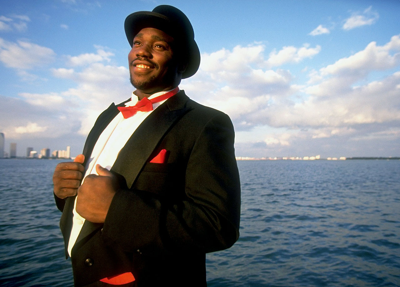 Warren Sapp poses in a tuxedo and top hat on March 3, 1995 in Miami.