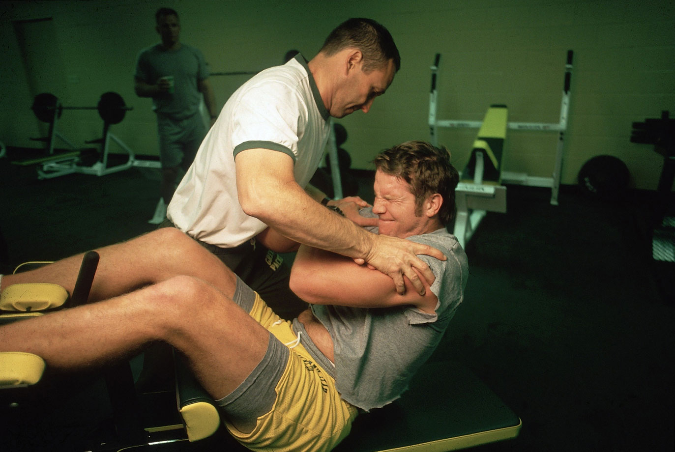 At 11 a.m. Favre leaves his house for the two-mile drive to the Packer training complex at Lambeau Field. There, strength-and-conditioning coach Kent Johnston sets to work on Favre's aching body, guiding him through exercises that include sit-ups and a medicine-ball drill designed to loosen his stiff joints and muscles.