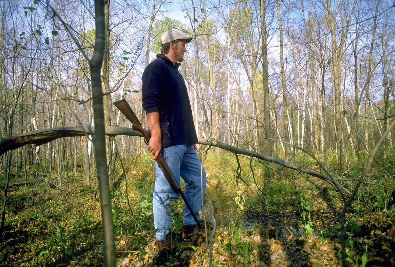 "At a private 200-acre hunting and fishing preserve, Favre goes in search of grouse, though not exactly by the book. ""Here, grousie! Come on out, grousie!"" he calls. The only fauna that respond to Favre's call are a couple of garter snakes."