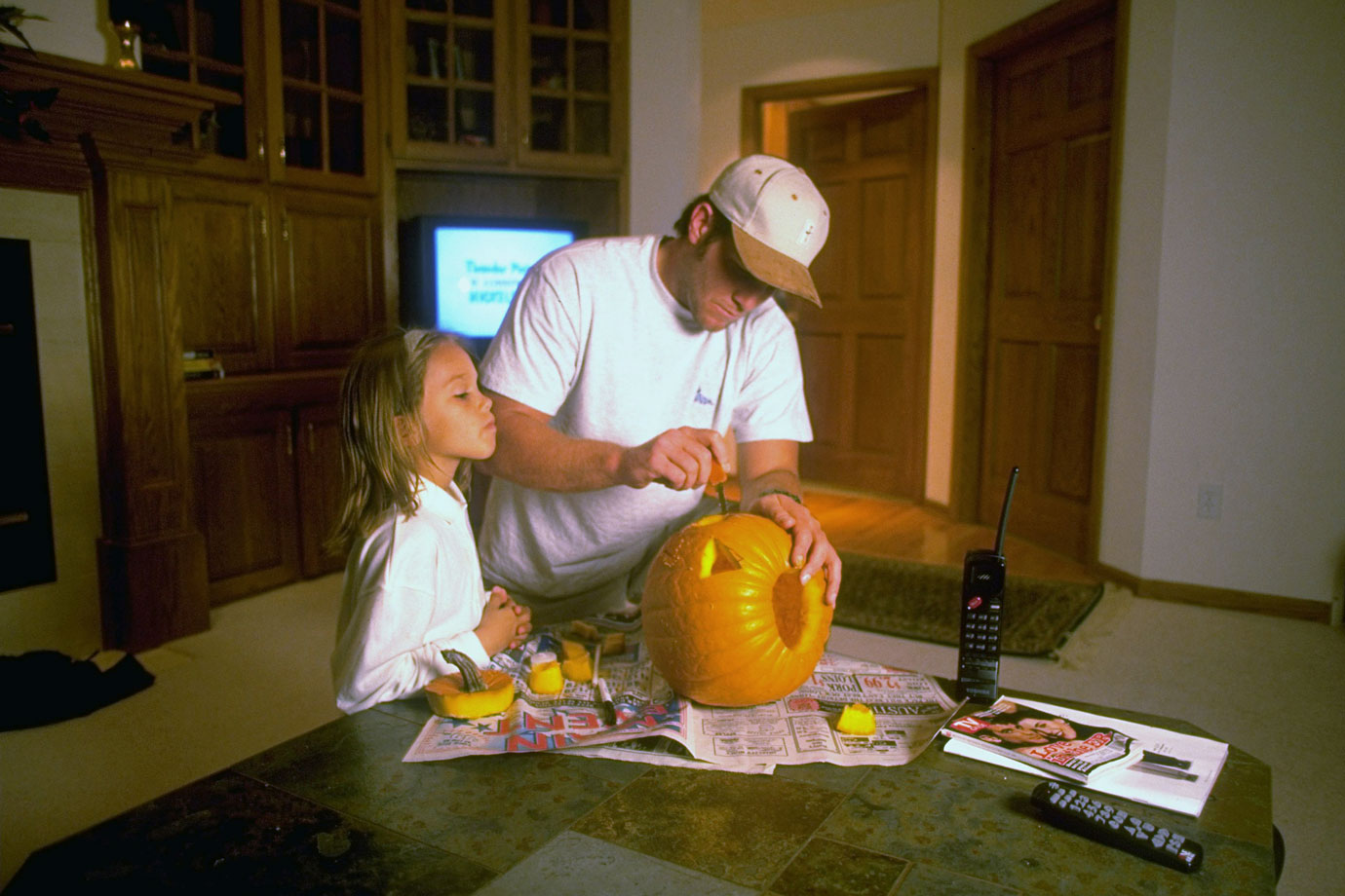 Favre then carves a pumpkin with his six-year-old daughter, Brittany...