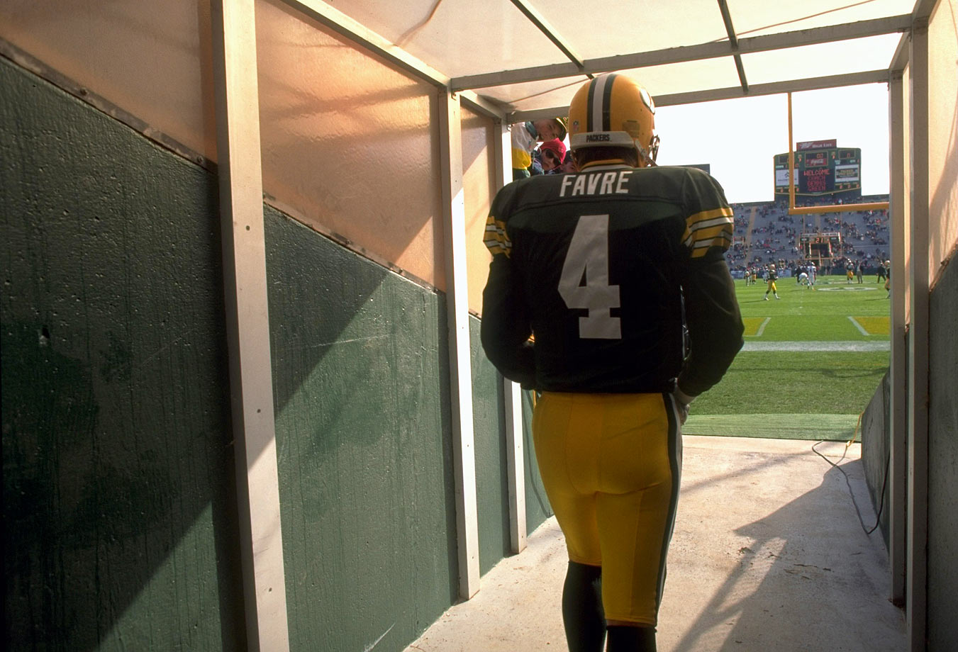Favre exits the tunnel to take the field for warmups before the game.
