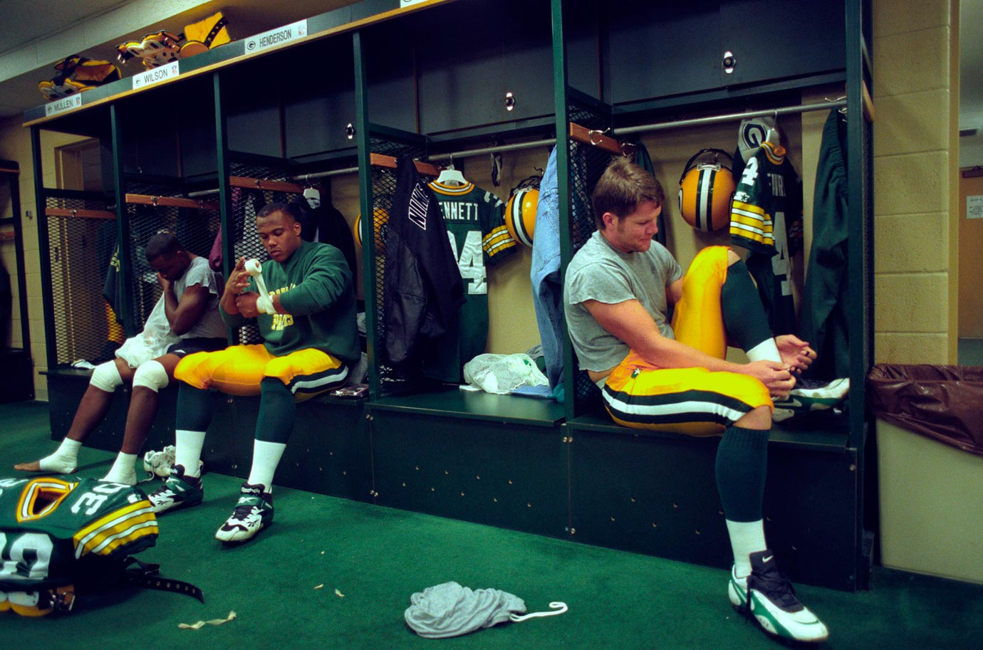 Favre ties his cleats in the locker room before Green Bay's game against Minnesota at Lambeau Field.