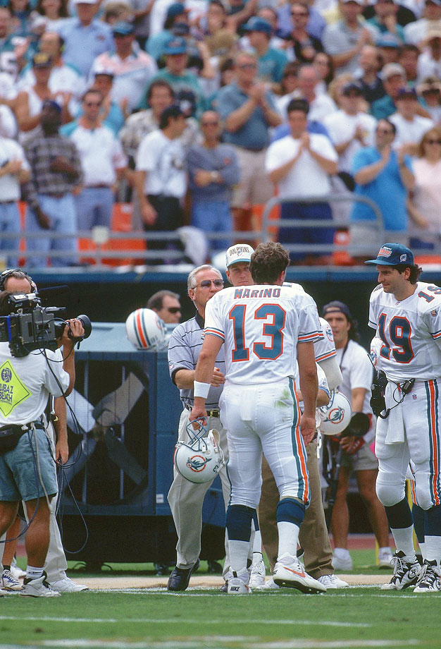 Head coach Don Shula looks to shake Dan Marino's hand after Marino broke Fran Tarkenton's NFL record of 47,003 passing yards during the Miami Dolphins game against the New England Patriots at Joe Robbie Stadium in Miami on Nov. 12, 1995.  The Patriots won the game, 34-17.