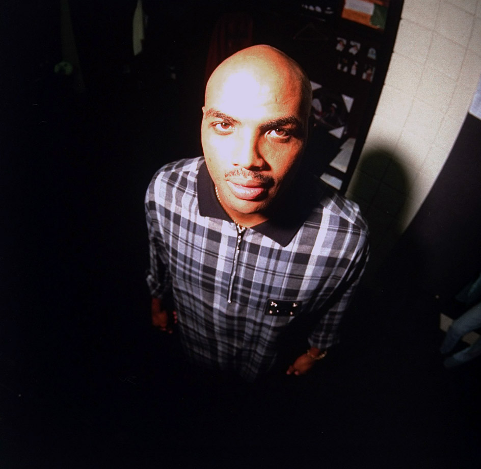 Charles Barkley poses for a portrait in the Phoenix Suns locker room. The Suns sent Barkley to the Houston Rockets after the 1994-95 season as part of a deal to land Chucky Brown, Mark Bryant, Sam Cassell and Robert Horry.