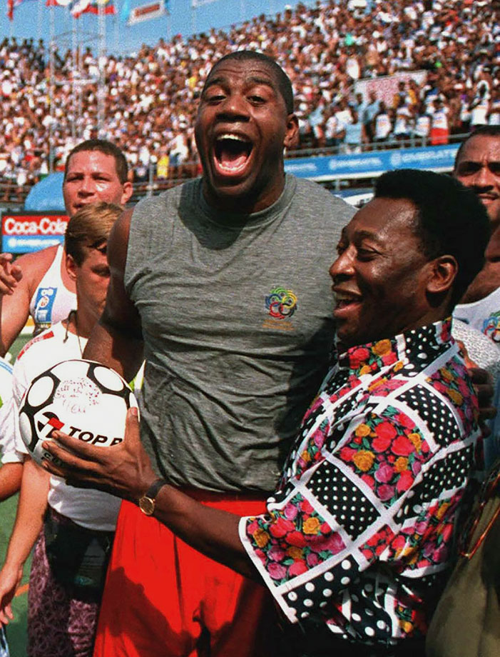 Pelé presents an autographed ball to Magic Johnson during his time in Rio de Janeiro on Feb. 5, 1995. Magic, a terrific athlete himself, was clearly pleased at receiving the souvenir.