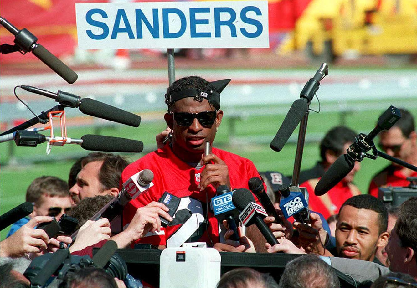 San Francisco cornerback Deion Sanders answers questions during Super Bowl XXIX Media Day in Miami. Prime Time had one interception in San Francisco's 49-26 victory over San Diego.