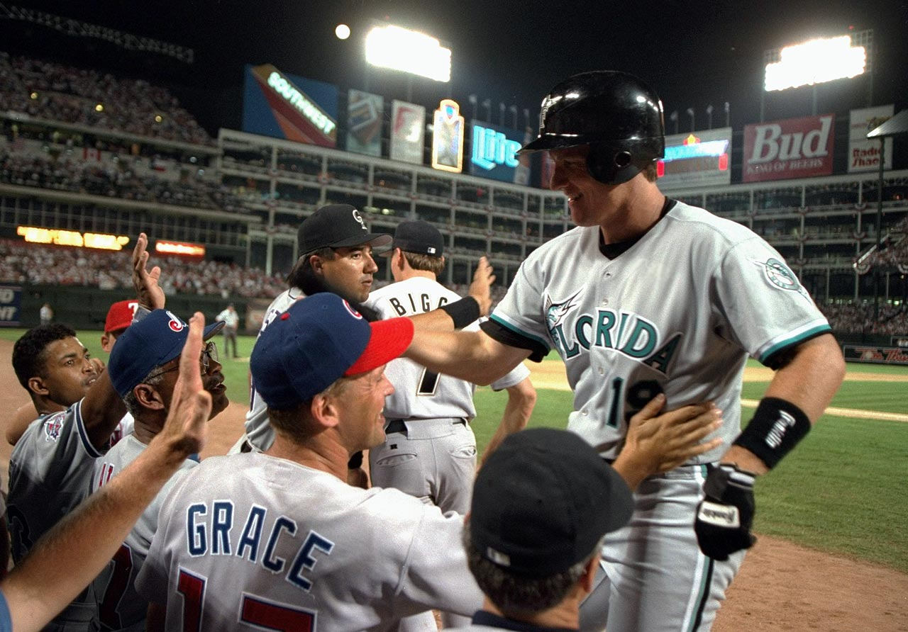 Jeff Conine, the nascent Marlins' lone representative, hit a tiebreaking home run in the eighth inning to give the NL a 3-2 win in Arlington, Texas, and stake a claim to the MVP trophy.