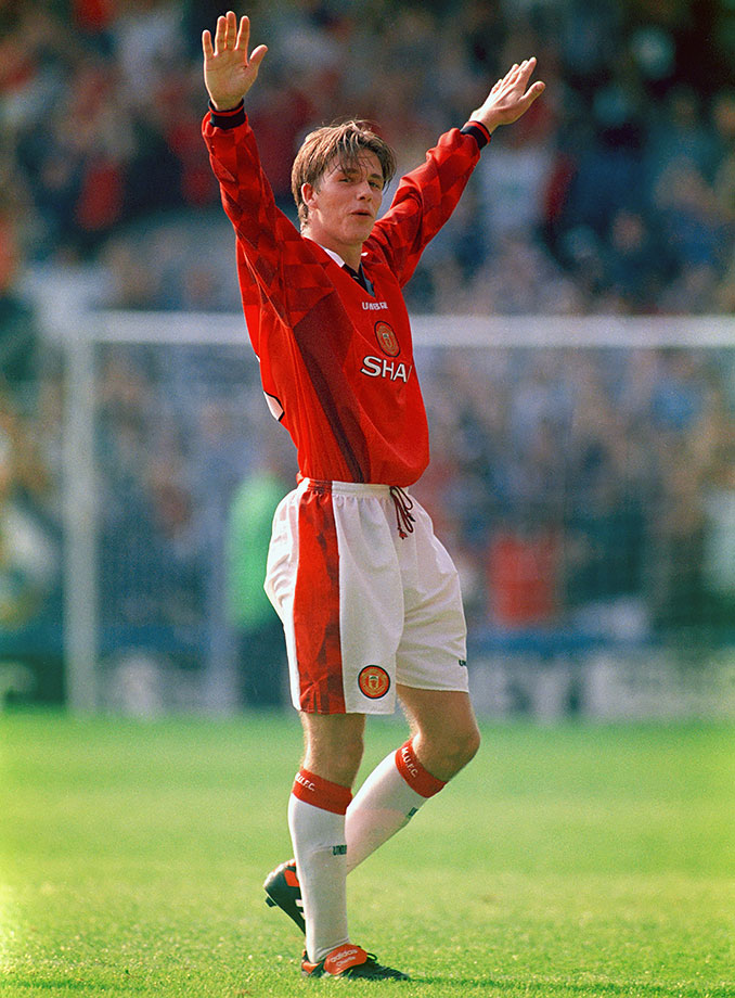 One of Beckham's most beautiful goals took place on Manchester United's first day of the 1996 season against Wimbledon. Man U was up by two when Beckham got the ball inside his own half. His eyes darted up for a second before he shot from midfield. The ball went sailing over Wimbledon goalkeeper Neil Sullivan's head and crashed into the back of the net. Two weeks later he played in his first game with the English national team.
