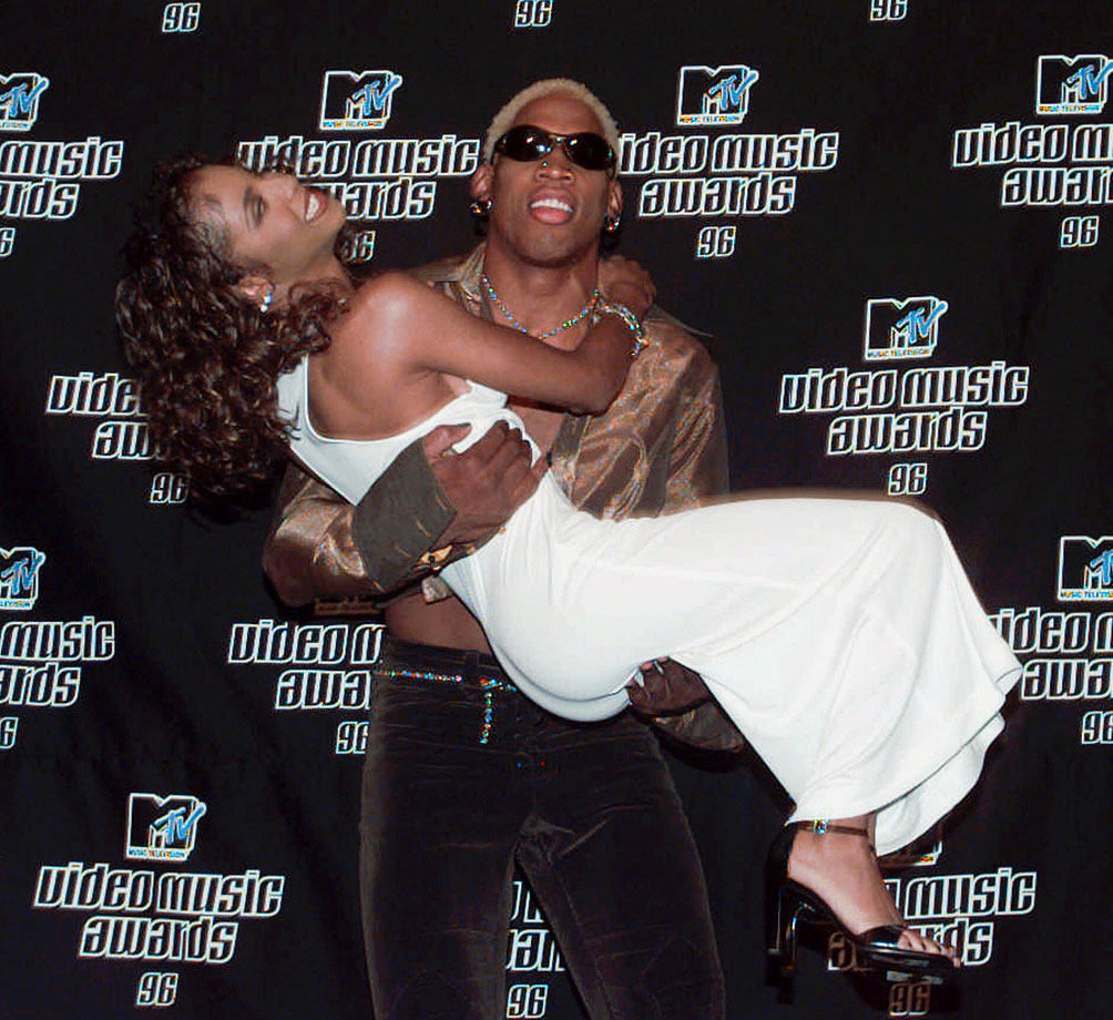 Rodman and singer Toni Braxton share a special moment on the red carpet at the 1996 MTV Video Music Awards.