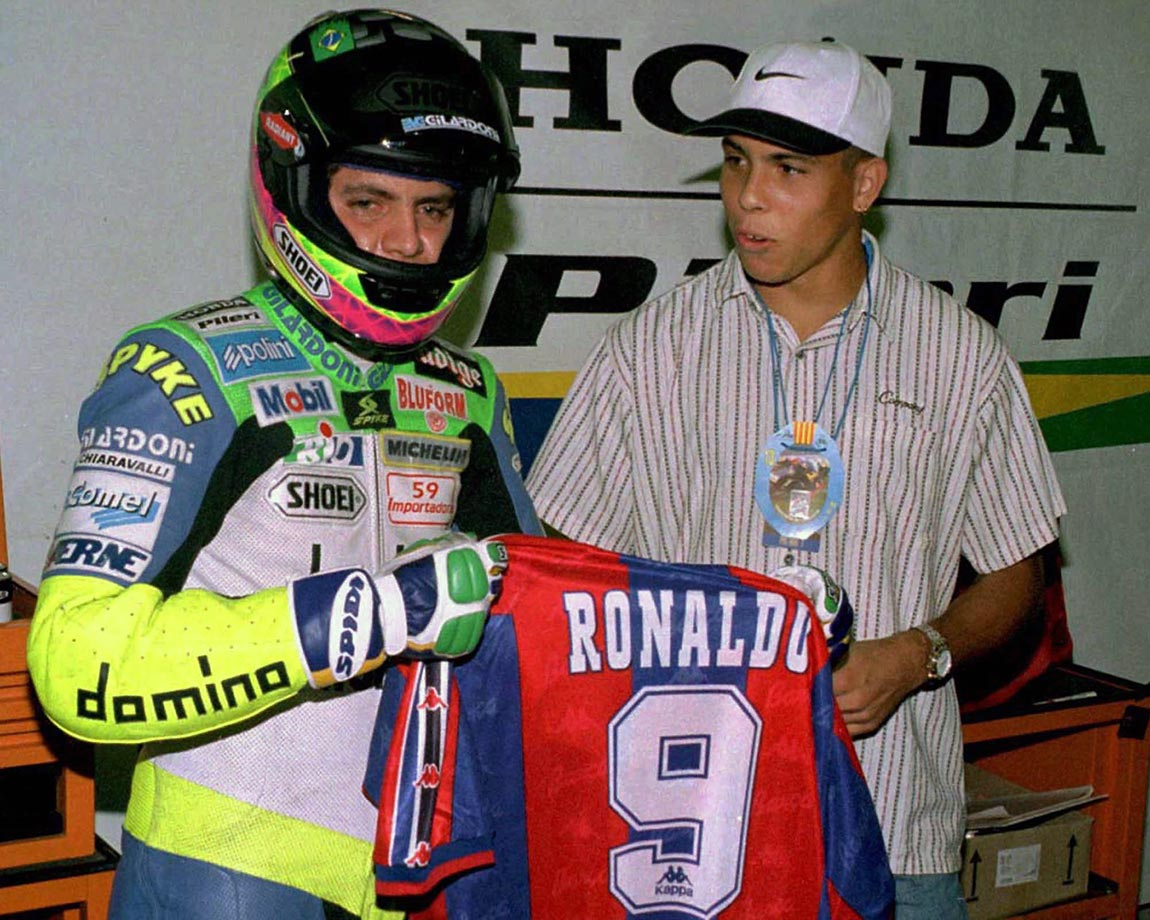 Ronaldo presents his FC Barcelona jersey to fellow Brazilian Alex Barros at the Montmelo circuit outside Barcelone in 1996. This was only the beginning of Ronaldo's interest in racing. Since 2005, Ronaldo has been the co-owner of A1 Team Brazil, a Brazilian Grand Prix racing team.