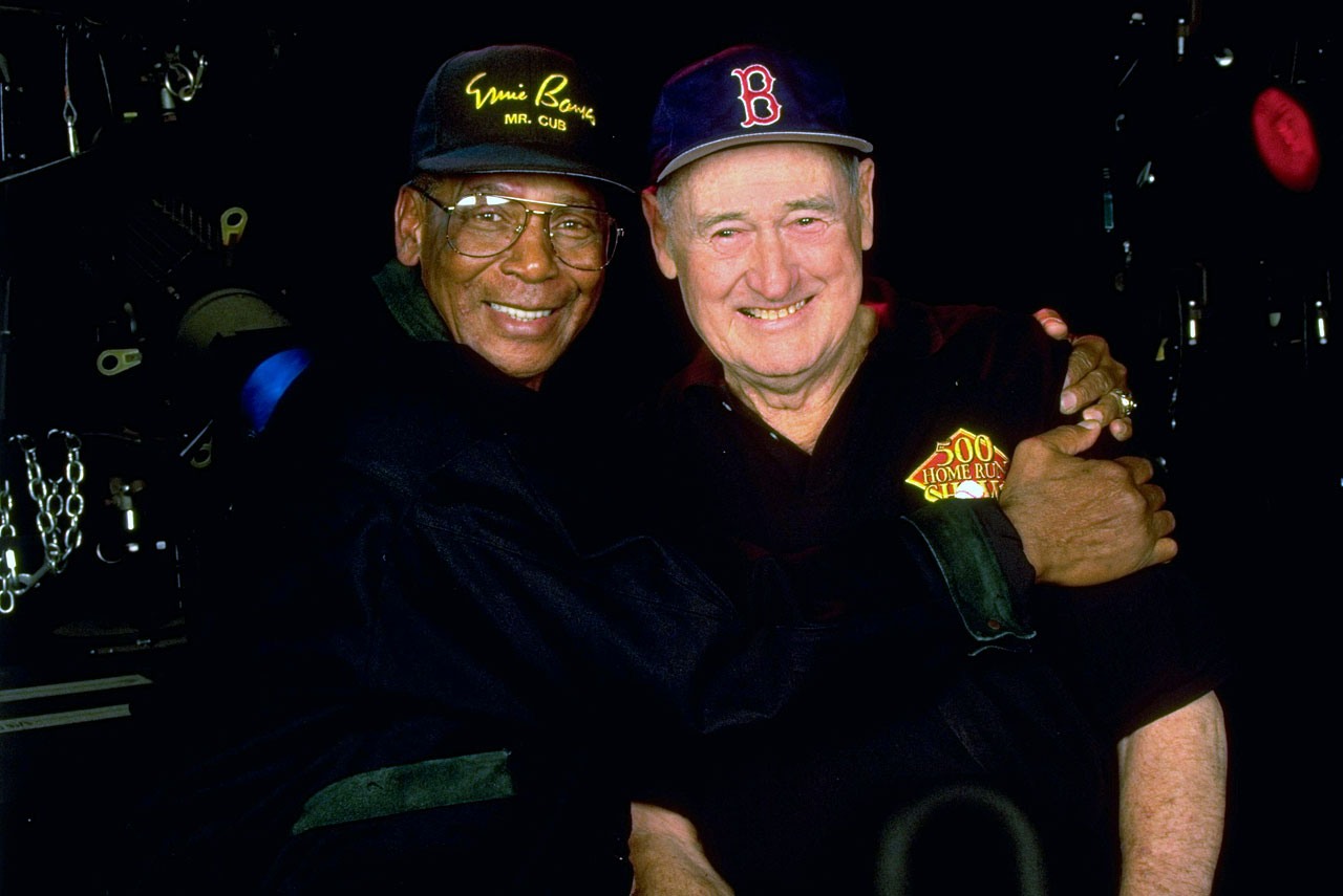 Ernie Banks hugs Ted Williams during the 500-hitters reunion.