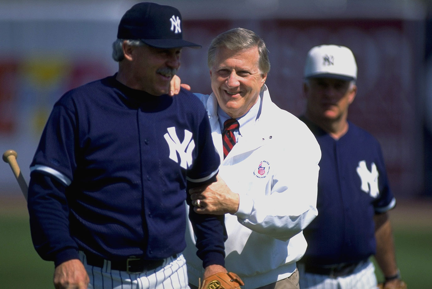 """George Steinbrenner jokes with coach Jim """"Catfish"""" Hunter during the New York Yankees spring training on Feb. 23, 1996 at Legends Field in Tampa, Fla."""