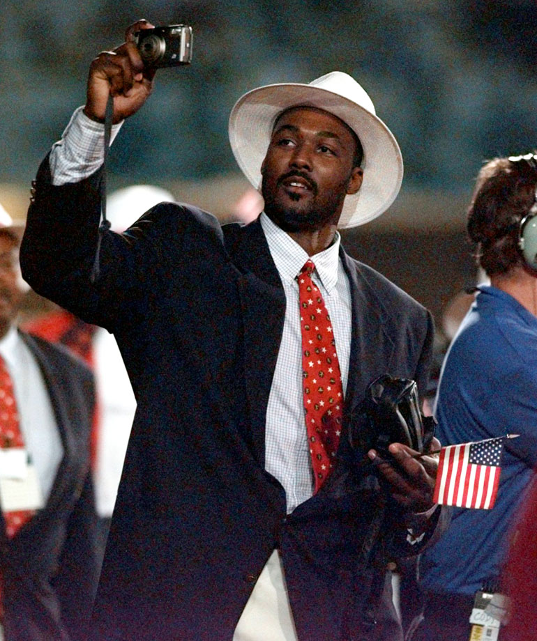 Karl Malone snaps some photos as he participates in the opening ceremonies of the 1996 Summer Olympics in Atlanta.