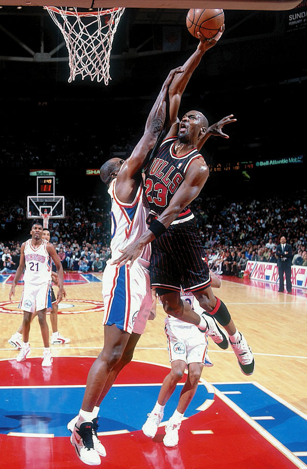 Michael Jordan goes up for a dunk against the 76ers in a January 1996 game in Philadelphia. Jordan had nine games with 40 or more points during the 1995-96 season, including 48 points against the 76ers.