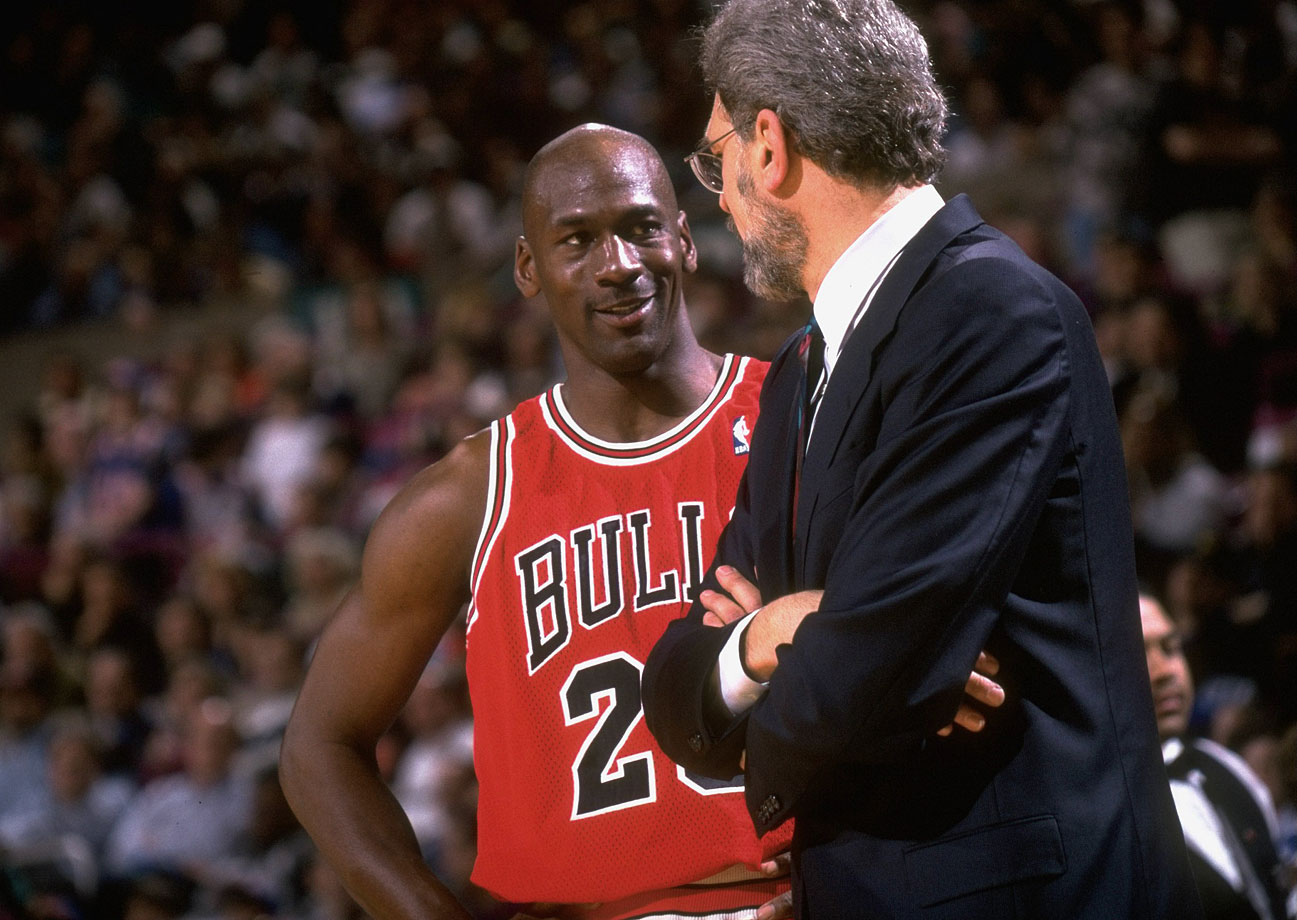 Michael Jordan talks with Bulls coach Phil Jackson on the sideline during Game 4 of the Eastern Conference semifinals against the New York Knicks in 1996. Coming off a record 72-10 regular season, the Bulls lost just three games in the postseason as Jordan claimed another championship in his first full season back from retirement.