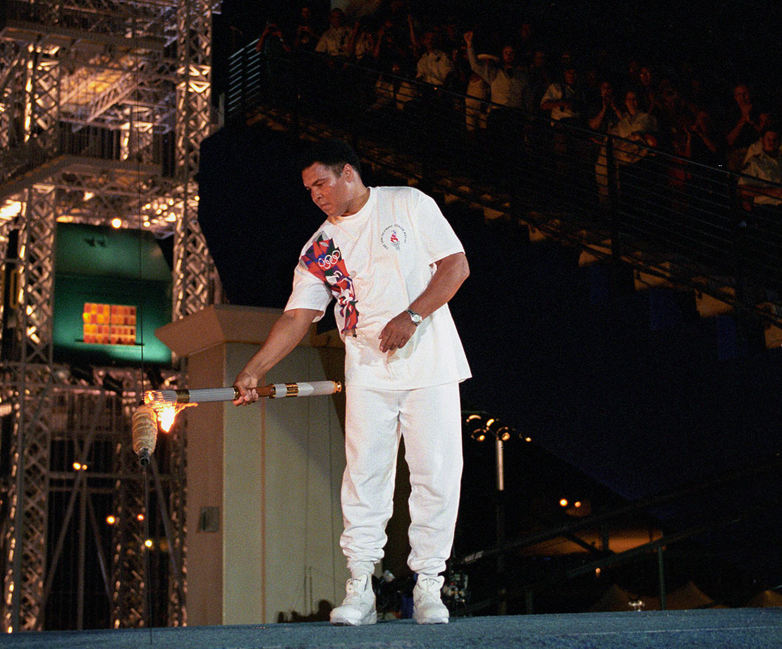 Ali carries the Olympic torch inside Centennial Olympic Stadium at the 1996 Atlanta Olympics. Despite trembling hands, Ali had the honor to light the Olympic flame in the stadium.