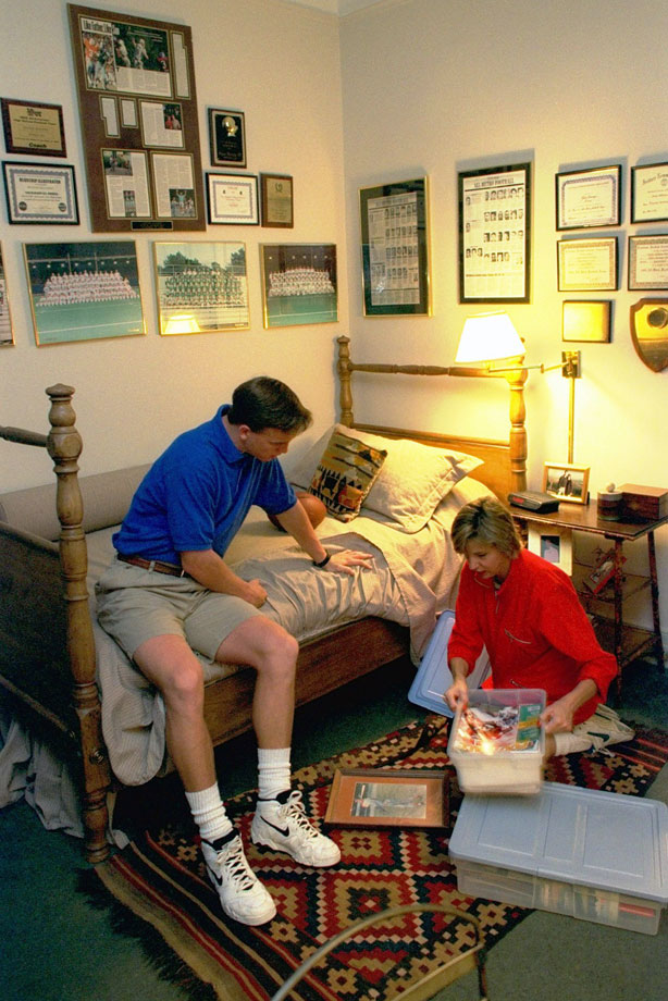Peyton Manning and mom Olivia sort through stuff in his bedroom at their home in New Orleans.