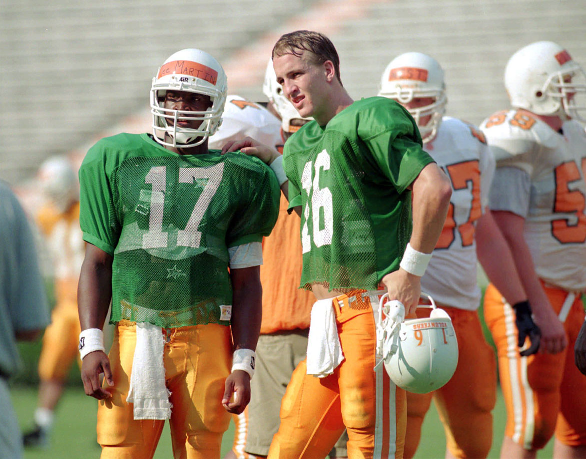 Peyton Manning gives some tips to backup quarterback Tee Martin during his Tennessee days.