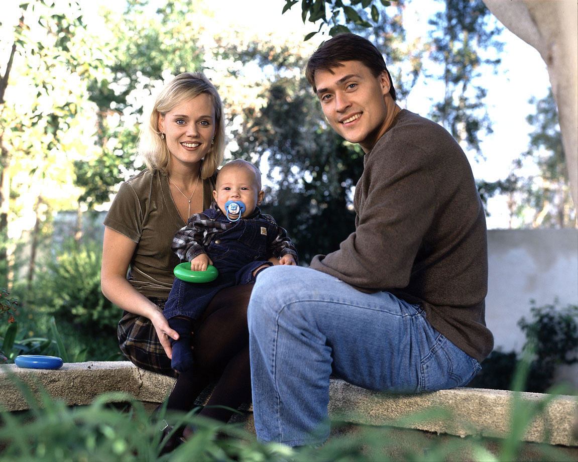 with his wife and son