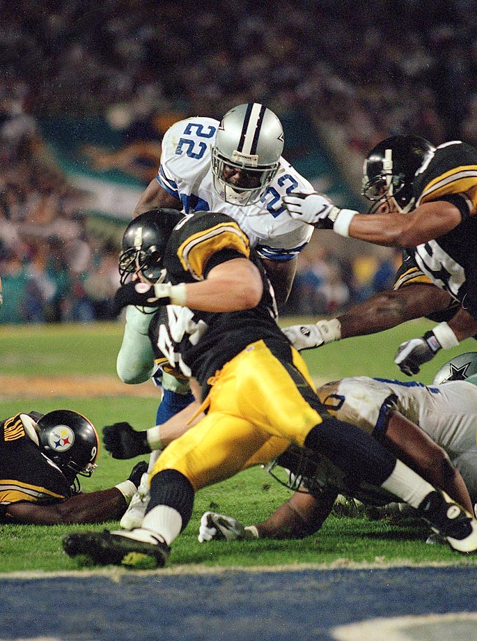 Emmitt Smith helped the Dallas Cowboys become the first team to win three Super Bowls in four years.