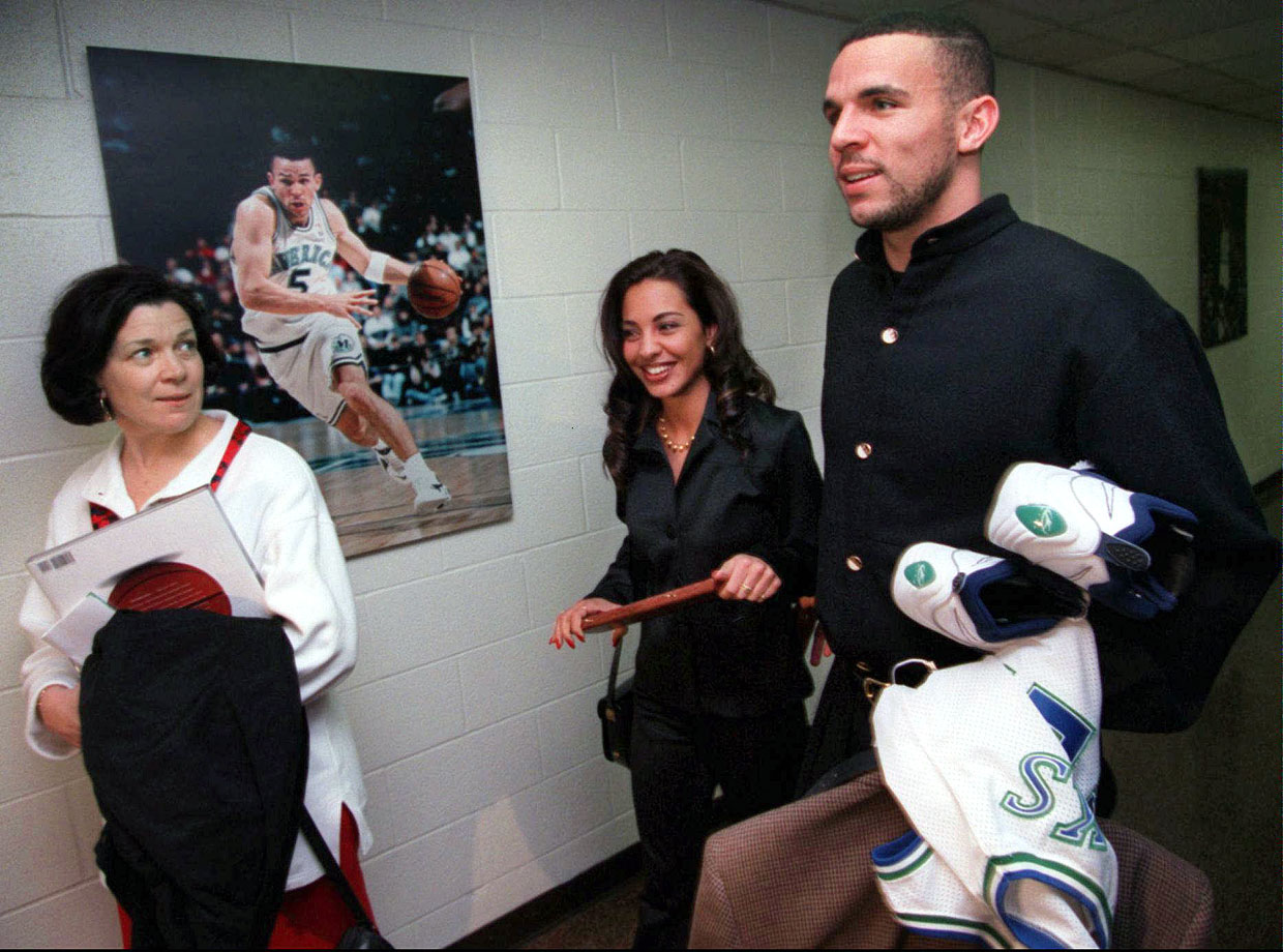 Jason Kidd walks out of Reunion Arena with his then-girlfriend Joumana and mother Anne after he was informed that he was traded to the Suns. Wonder how long that poster was up.