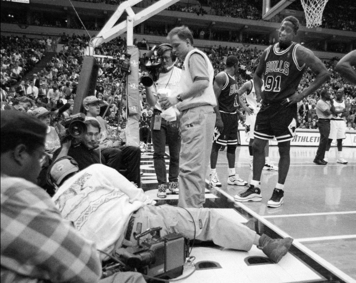 In one of his most memorable on-court showings, Rodman stumbled out of bounds and fell on top of TV operator Eugene Amos during a game against the Timberwolves in 1997. Rodman then kicked Amos in the groin, requiring the cameraman to be taken away by stretcher. Rodman was suspended 11 games without pay and ended up paying Amos a $200,000 settlement.