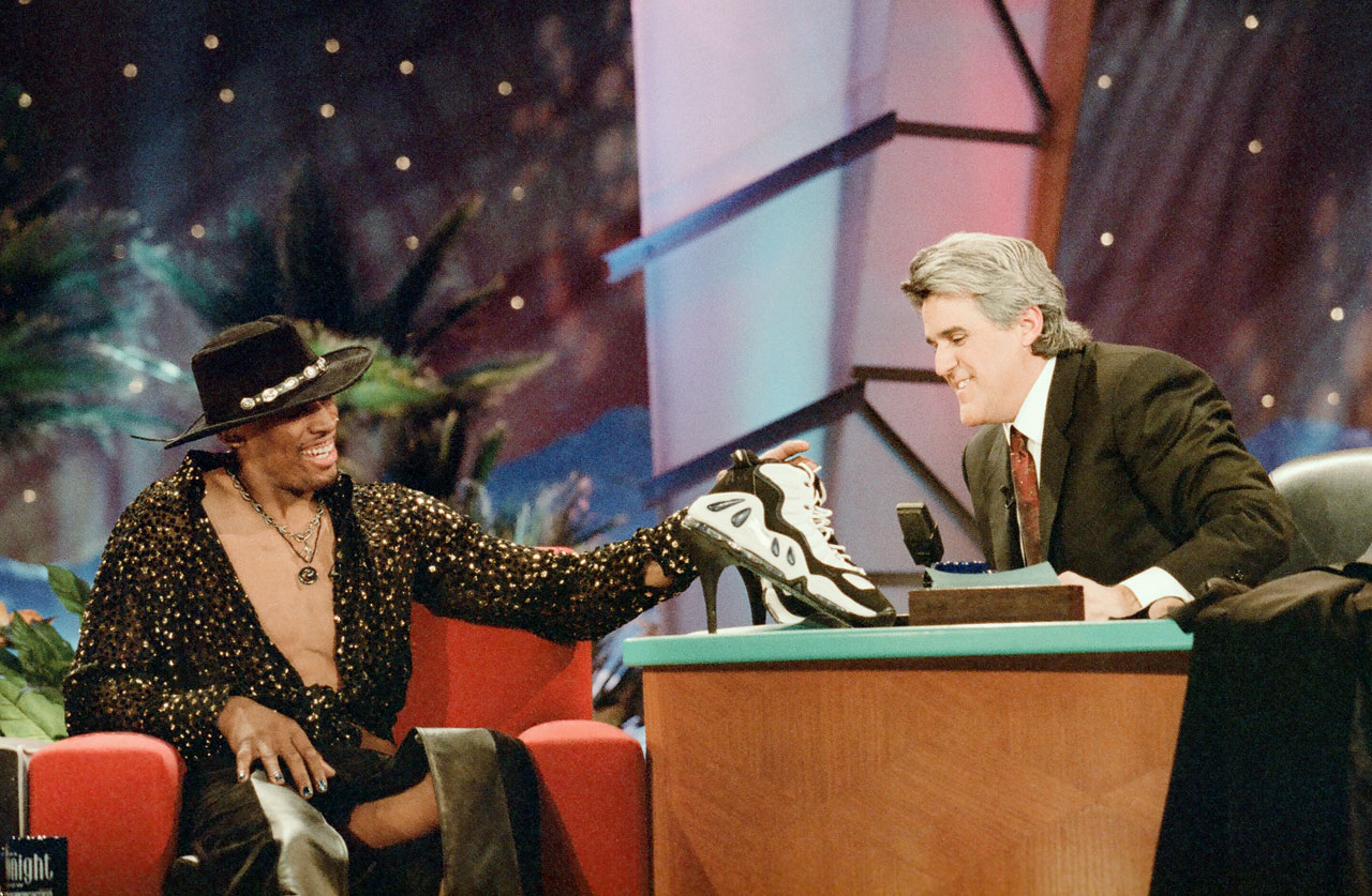 "Leno presented Rodman with a pair of high-heeled basketball shoes during the taping. ""The Worm"" autographed the kicks and handed them to a woman in the front row."